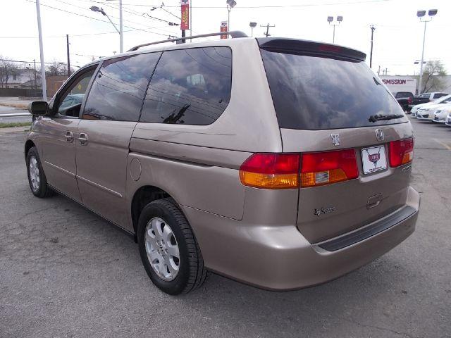 Honda Odyssey 4dr Quad Cab 160.5 DRW 4WD Laramie MiniVan